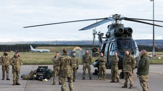 Cover image: RAF personnel and a Puma helicopter arrive at Kinloss Barracks (Picture: MOD).