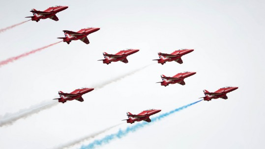Red Arrows flying in formation at RAF Scampton Airshow in 2017