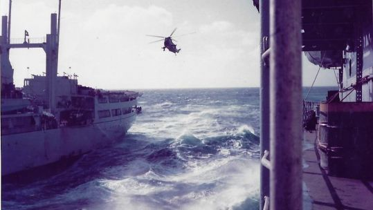 A resupply at sea for the task force heading south, 1982. Credit: Kevin Lambert.