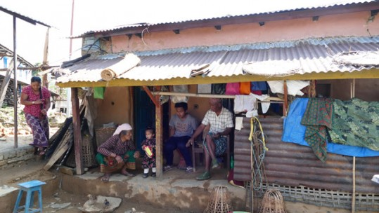 Rifleman Kul Bahadur Gurung with his family outside their temporary accommodation