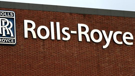 Rolls-Royce sign on building (Picture: PA).