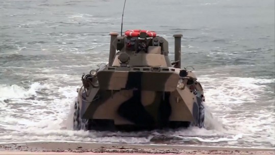 Russian Military Vehicles Storm Beach