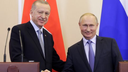 Russian President Vladimir Putin shakes hands with Turkish President Recep Tayyip Erdoğan (Picture: PA).