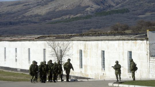 Russian troops outside Perevalnoye military base in Crimea