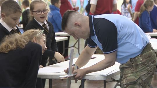 STEM students get help from RAF airman to build a glider