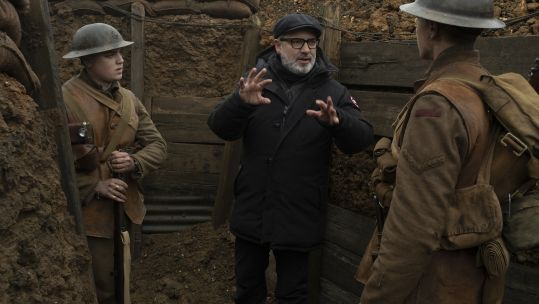 Sam Mendes on set with lead actors, George McKay and Dean-Charles Chapman