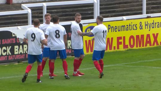 Sam Atkinson celebrates scoring the winner with his team mates.