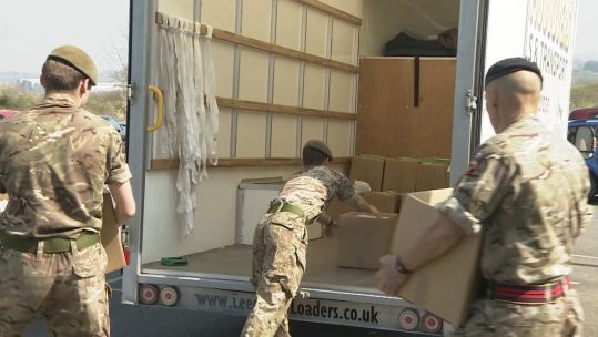 Scots Guards unloading equipment on Isle of Wight.
