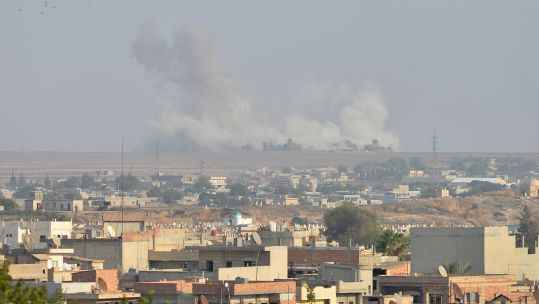 Smoke rises from Syrian city of Ras al Ayn following an attack from Turkey (Picture: PA).