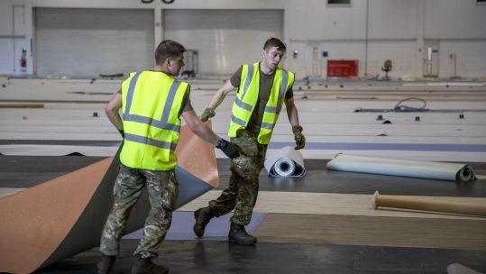 Cover image: Soldiers help to build London's NHS Nightingale facility (Picture: MOD).