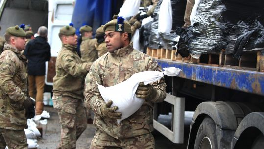Soldiers from 4th Battalion, The Royal Regiment of Scotland, in Mytholmroyd, Yorkshire to assist with flood defences (Picture: PA).