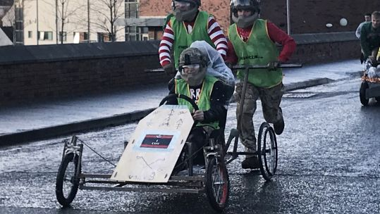 Cover image: Soldiers of 2 Rifles enjoy improvised sleigh races at Thiepval Barracks in Co Antrim (Picture: PA).