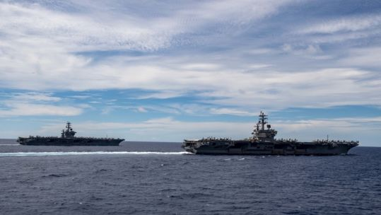 Cover image: USS Ronald Reagan and USS Nimitz in the South China Sea (Picture: US Department of Defense).