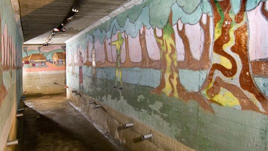 Cover image: TheSt John's School boys' air raid shelter includes a number of murals, depicting scenes from stories such as Treaure Island and Robin Hood (Picture: Historic England Archive).