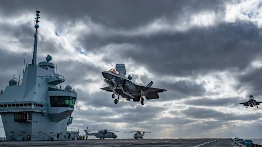 The view of HMS Queen Elizabeth's flight deck during operational testing with the UK's F-35B Lightning jets. by Kyle Heller (Picture: Royal Navy).