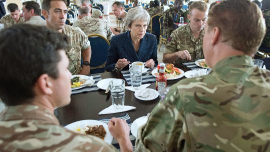 Theresa May eats lunch with British soldiers in Kenya CREDIT BFBS