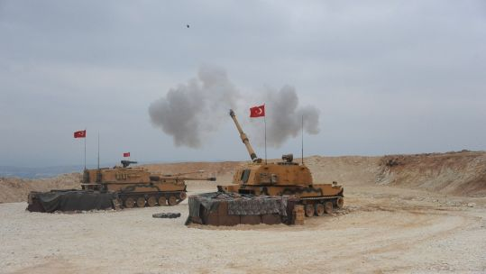 Turkish tanks launch an attack on north-eastern Syria (Picture: PA).