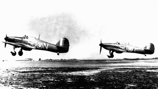Two RAF Hawker Hurricane MK1 fighters from RAF 79 Squadron taking off from RAF Hawkinge during the Battle of Britain (Picture: PA).