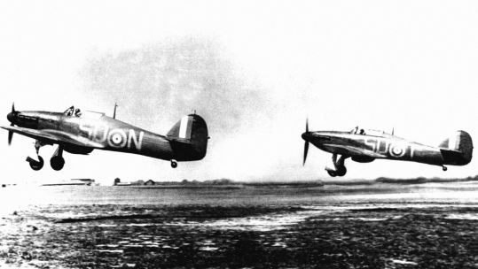 Two RAF Hawker Hurricane MK1 fighters from RAF 79 Squadron taking off from RAF Hawkinge, Kent during the Battle of Britain (Picture: PA).