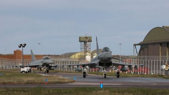 Two RAF Typhoon jets line up on taxiway at RAF Lossiemouth.