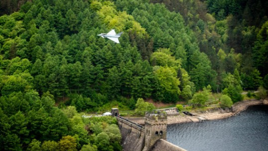 A Typhoon flies over the Derwent Dam in Derbyshire as part of the Dambusters 75th anniversary (Picture: PA).
