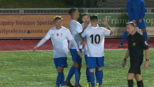 UKAF footballers celebrate goal against Worthing FC.