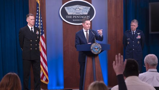 Cover Image: Jonathan Hoffman speaks to reporters at the Pentagon (Picture: US Department of Defense).