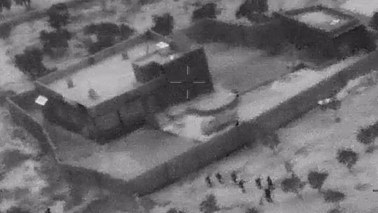 US forces are shown approaching the building before the raid (Picture: US Department of Defense).