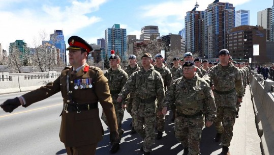 British troops parade with Canadian colleagues in Calgary to commemorate the 100th anniversary of the Battle of Vimy Ridge