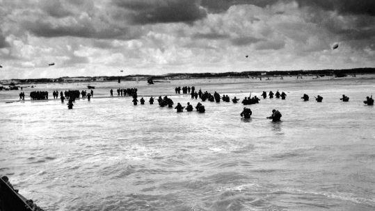 U.S. troops wading to Utah Beach during the D-Day invasion of Normandy on June 6-8, 1944.