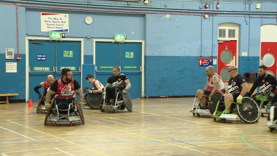 Team UK's wheelchair rugby side against Welsh outfit, RGC.
