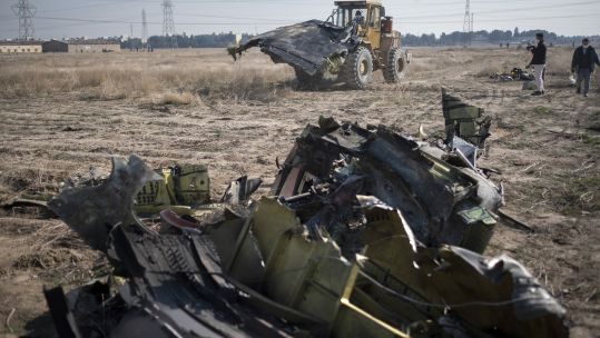 Wreckage at the site of a crash of an Iranian Boeing 737 jet about 30 miles south of Tehran, Wednesday (Picture: PA).